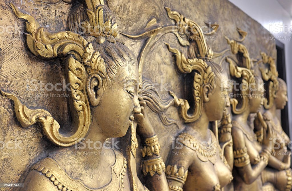 Native culture Thai sculpture on the temple wall stock photo