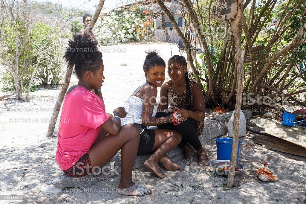 Native Malagasy Sakalava ethnic girls, beauties with decorated face stock photo