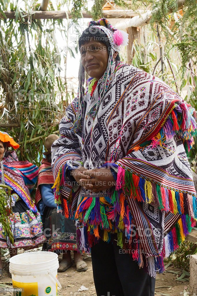 Native Peruvian man wearing a handwoven poncho and a chollo stock photo