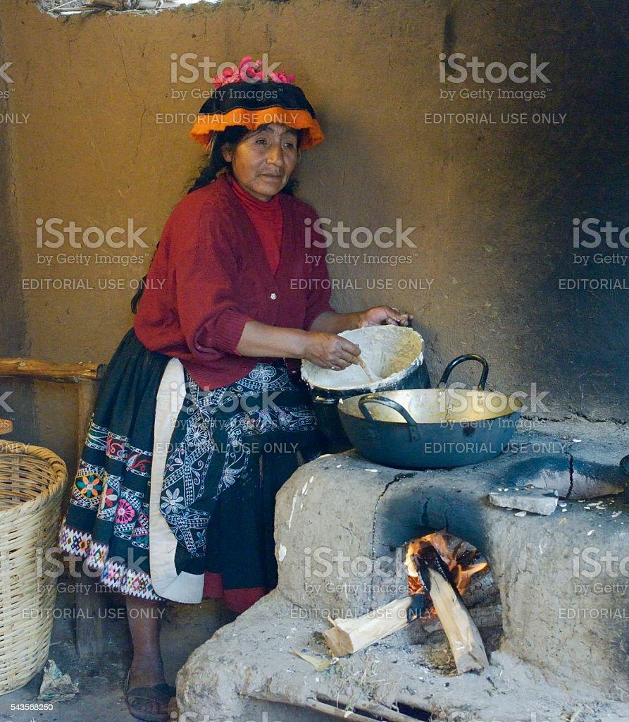 Native Peruvian woman preparing Cachangas aka fried bread stock photo