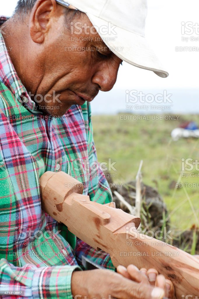 Native Rapanuian Man Carving a Statue royalty-free stock photo