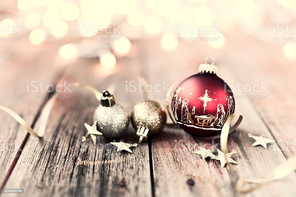 Nativity Christmas Ornaments with Decorations and Ribbon on Wood Background stock photo