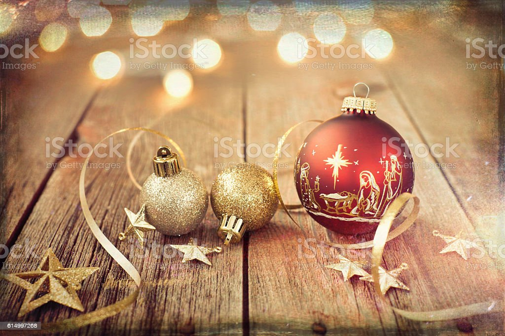 Nativity Christmas Ornaments with Decorations and Ribbon on Wood stock photo