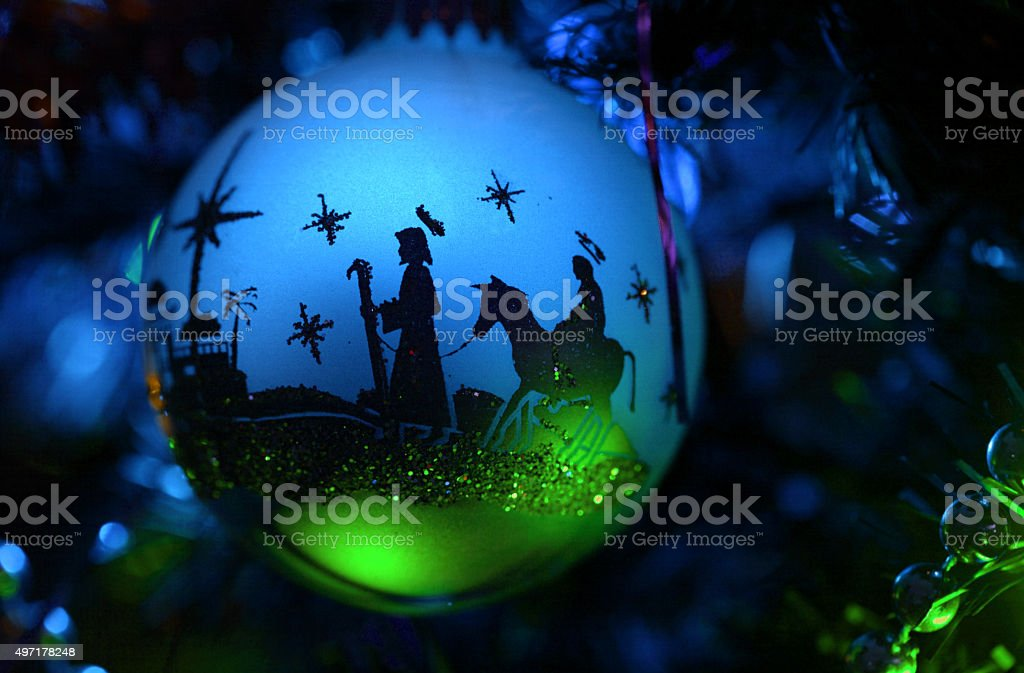 Nativity silhouette ornament with turquoise blue and green lights stock photo