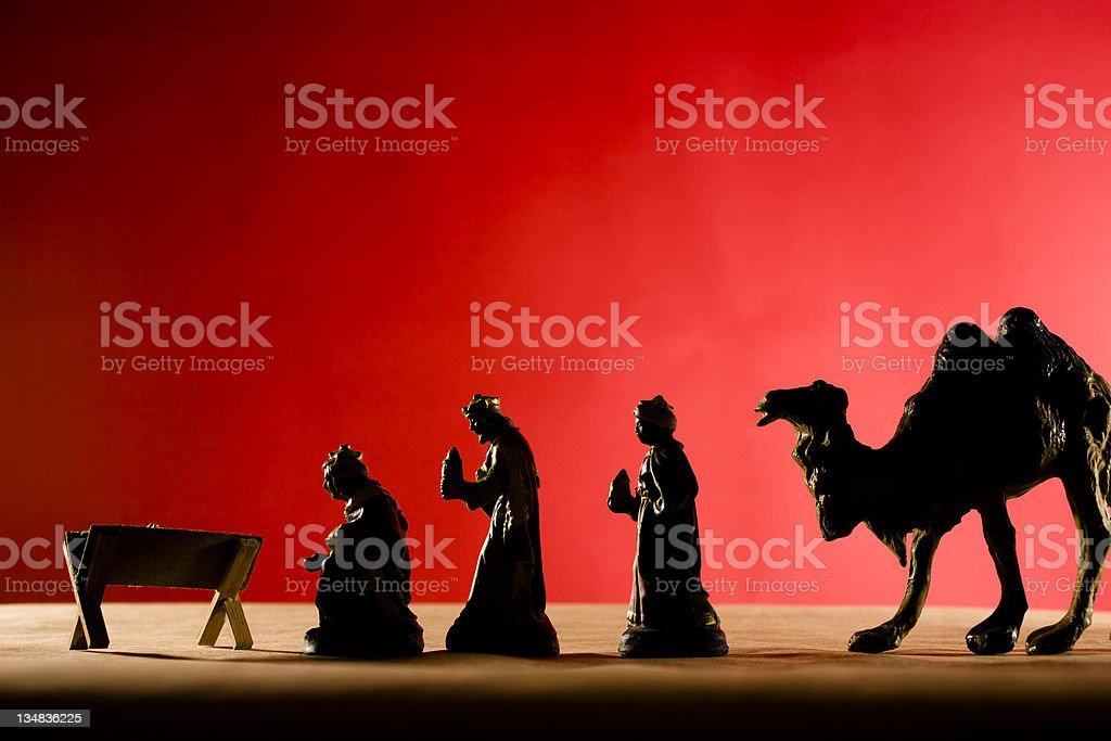 Nativity. Three wisemen and camel at manger of Jesus.  Christmas. royalty-free stock photo