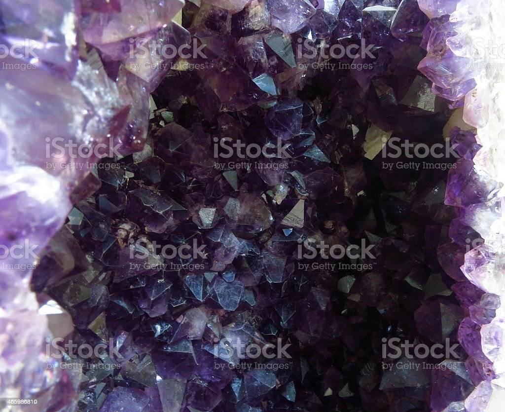 Natural amethyst, purple crystal stone isolated, mineral stock photo