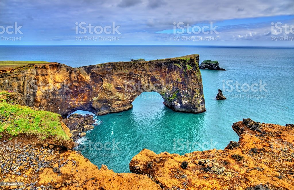 Natural arch of Dyrholaey Peninsula - Iceland stock photo