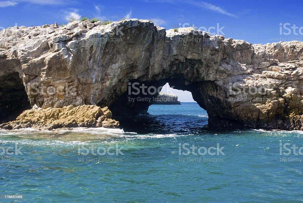 A natural arch on the shoreline stock photo