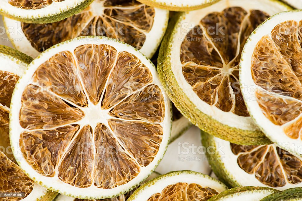 natural background dry sliced lemon, top view close-up stock photo