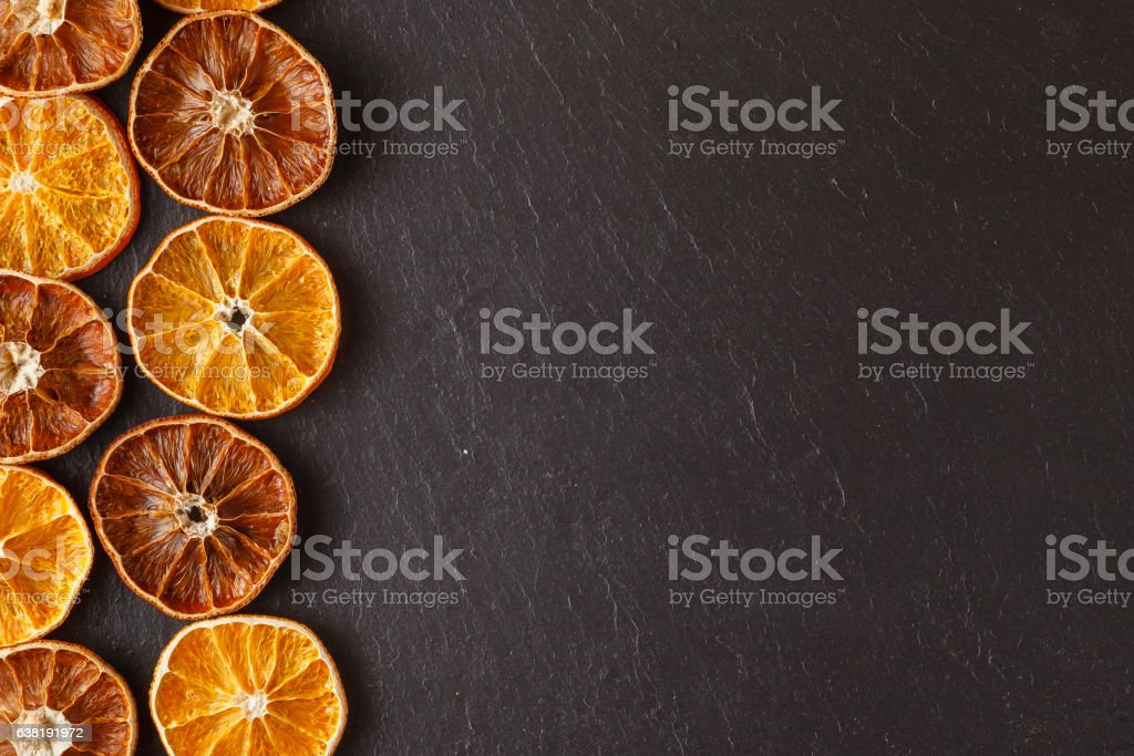 natural background dry sliced oranges stock photo