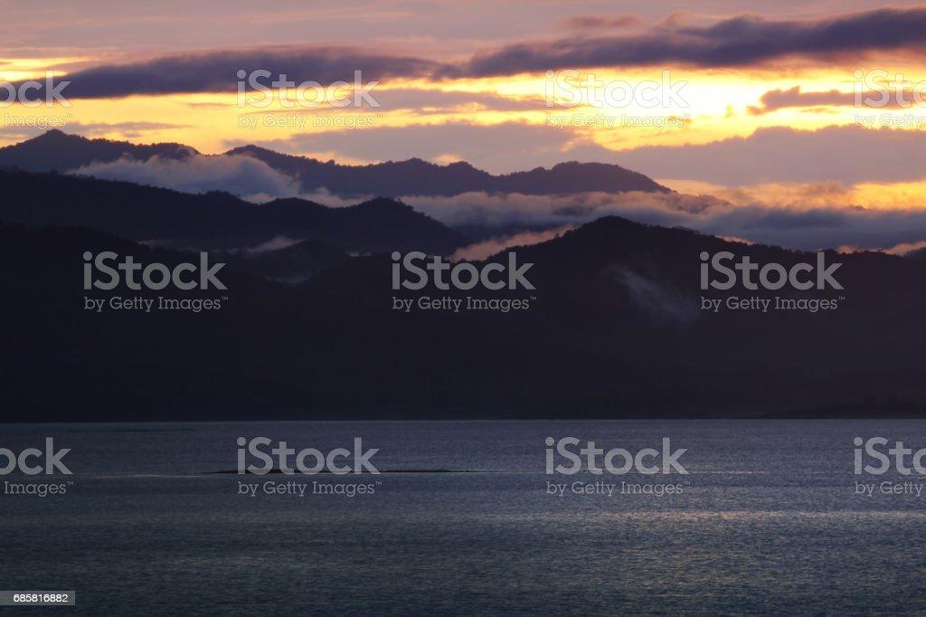 Natural background of colorful sky and mountain during sunset at Kaeng Krachan Dam, Kaengkrachan National Park ,Petcahburi  in Thailand. Attractions and natural Concept. stock photo