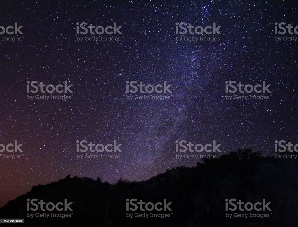 Natural background of the starry sky and milky way at night of Doi Luang Chiang Dao at Chiang Mai province in Thailand. Long exposure shooting and high iso used make this photo have noise stock photo