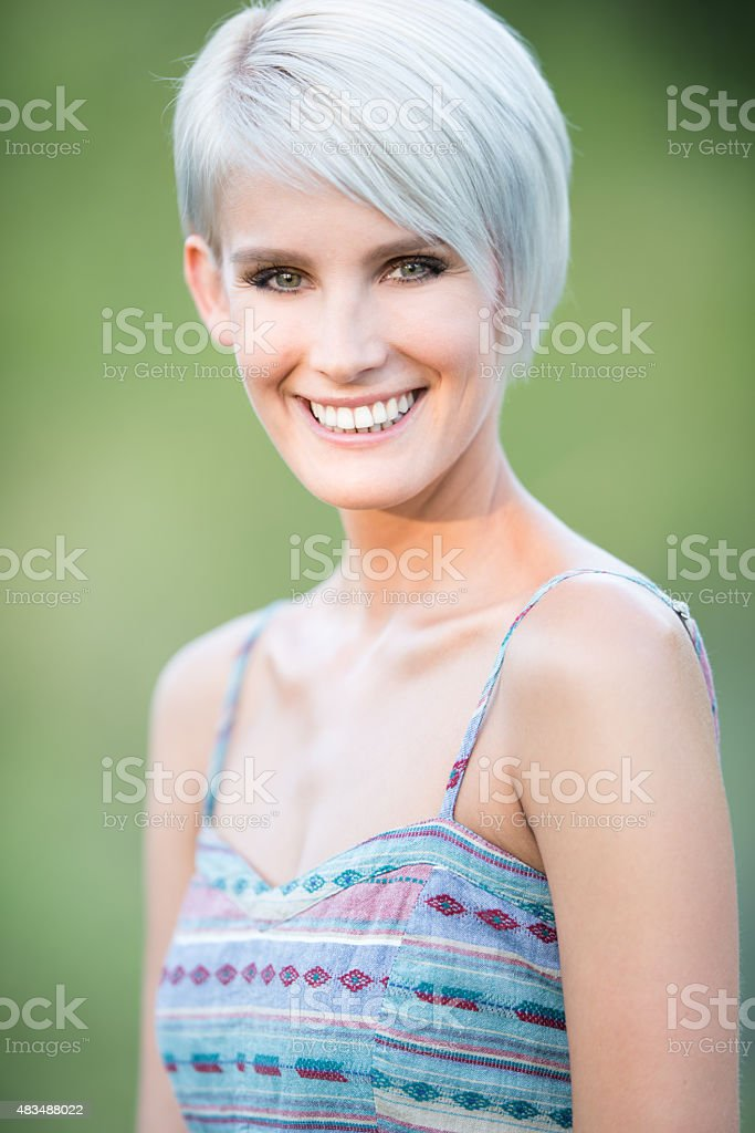 Natural Bautiful Blond with a playful candid Smile stock photo