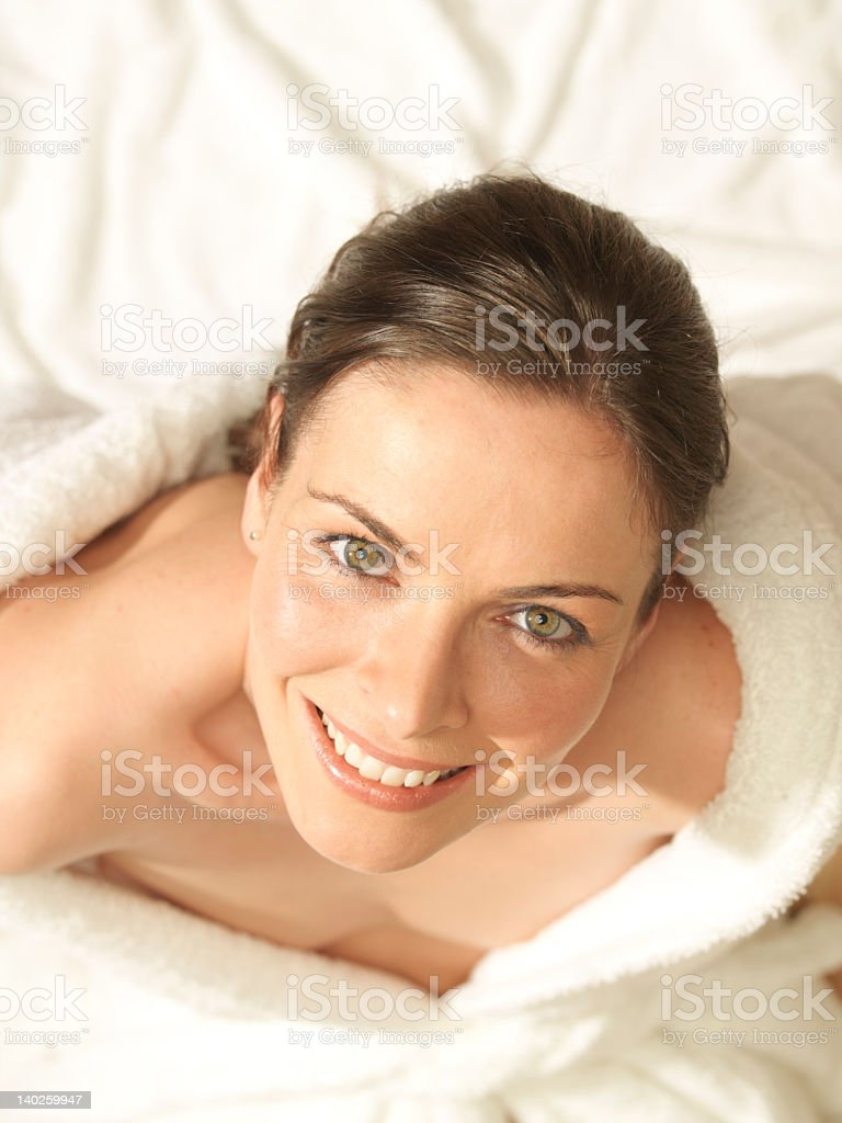 Natural beautiful woman looking up smiling, white background stock photo
