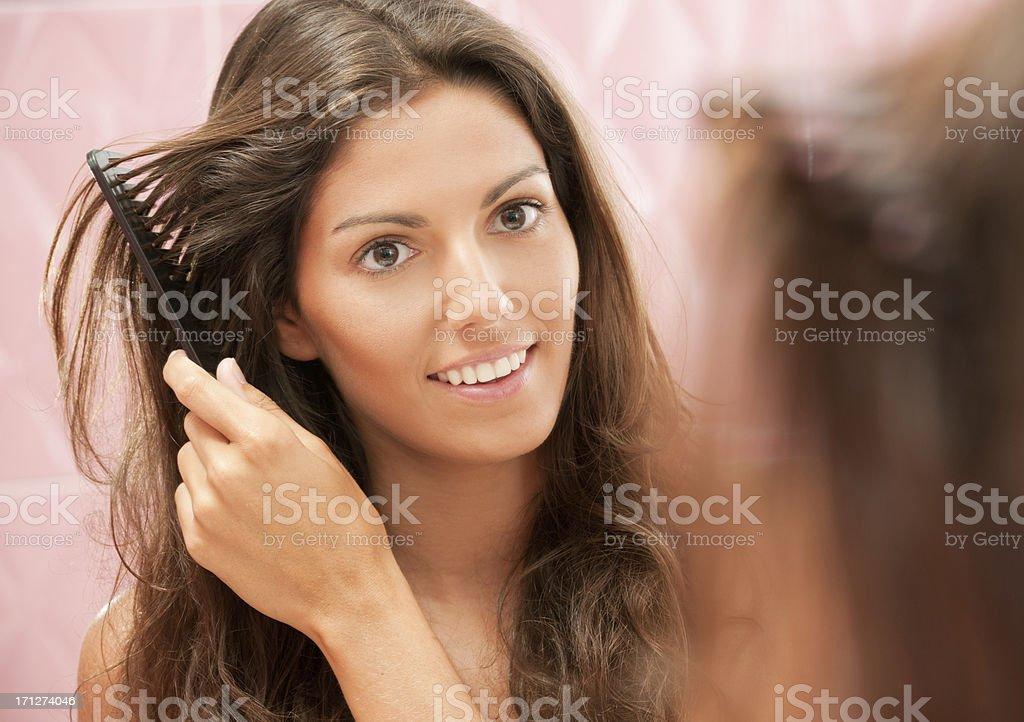 Natural beautiful Woman styling her Hair (XXXL) stock photo