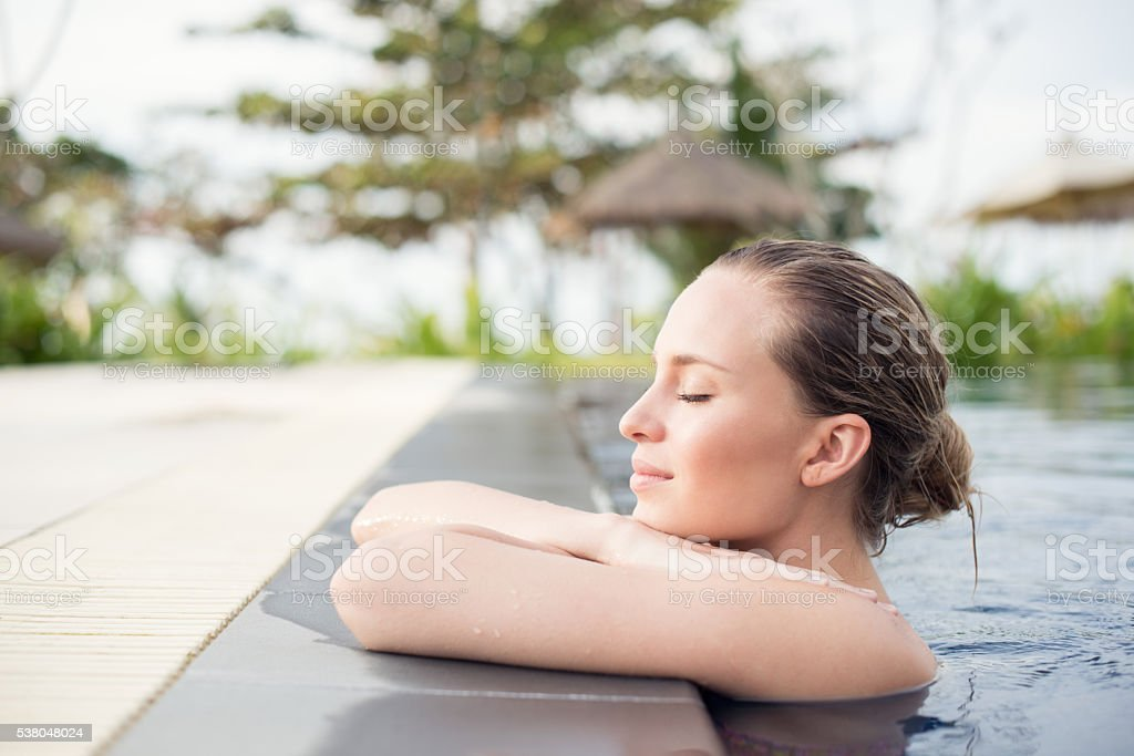 Natural Beauty relaxing at a Tropical SPA stock photo