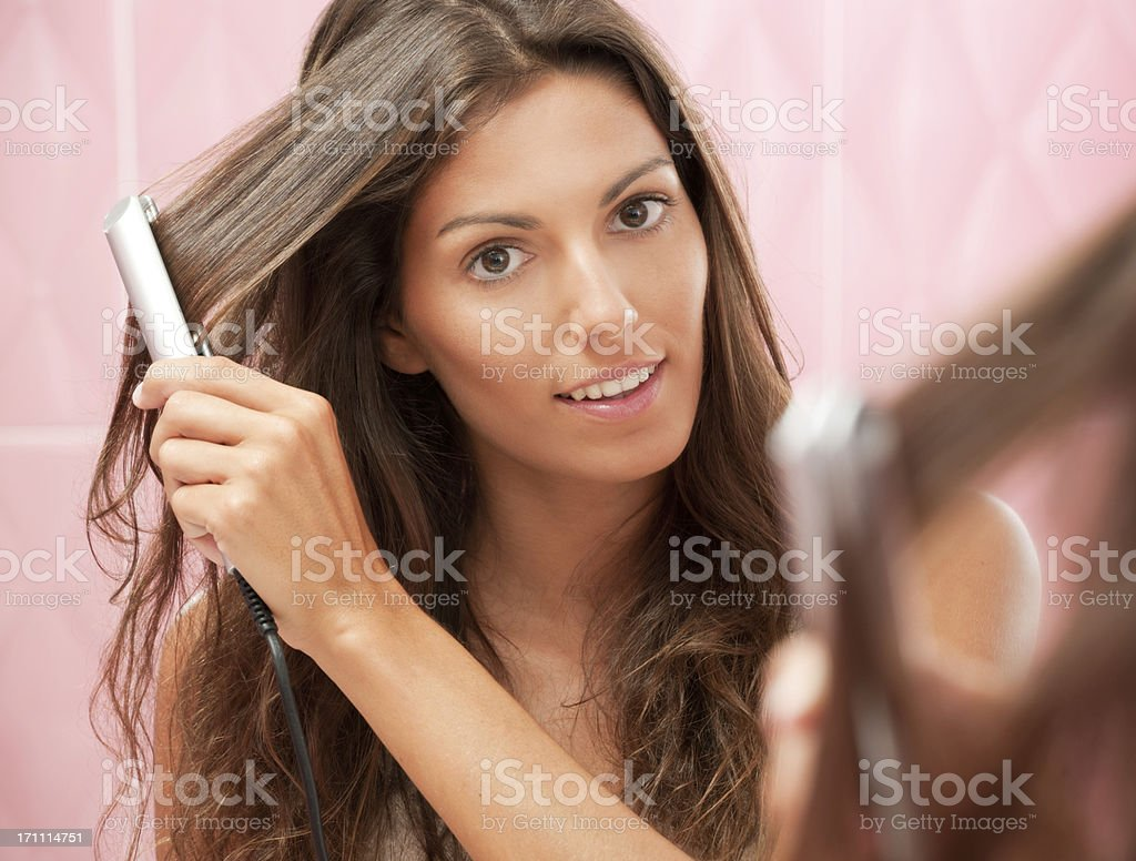Natural Beauty straightening her long Hair stock photo