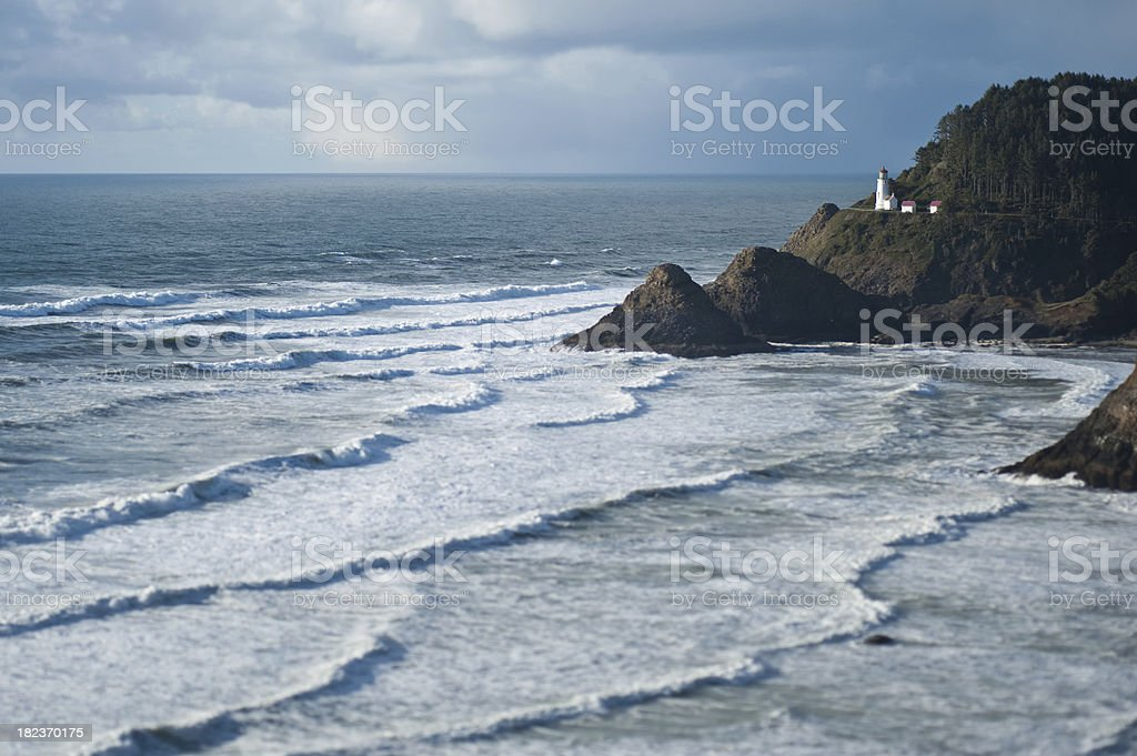 Natural blue tint stormy sky Heceta Head LIghthouse Oregon Coast stock photo