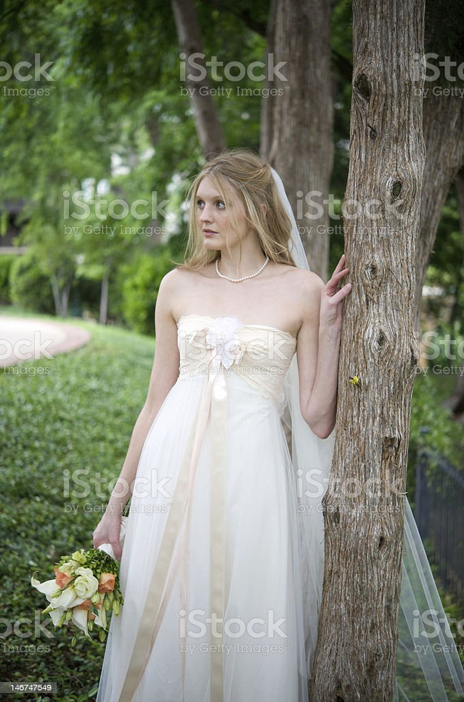 Natural bride gazing off stock photo