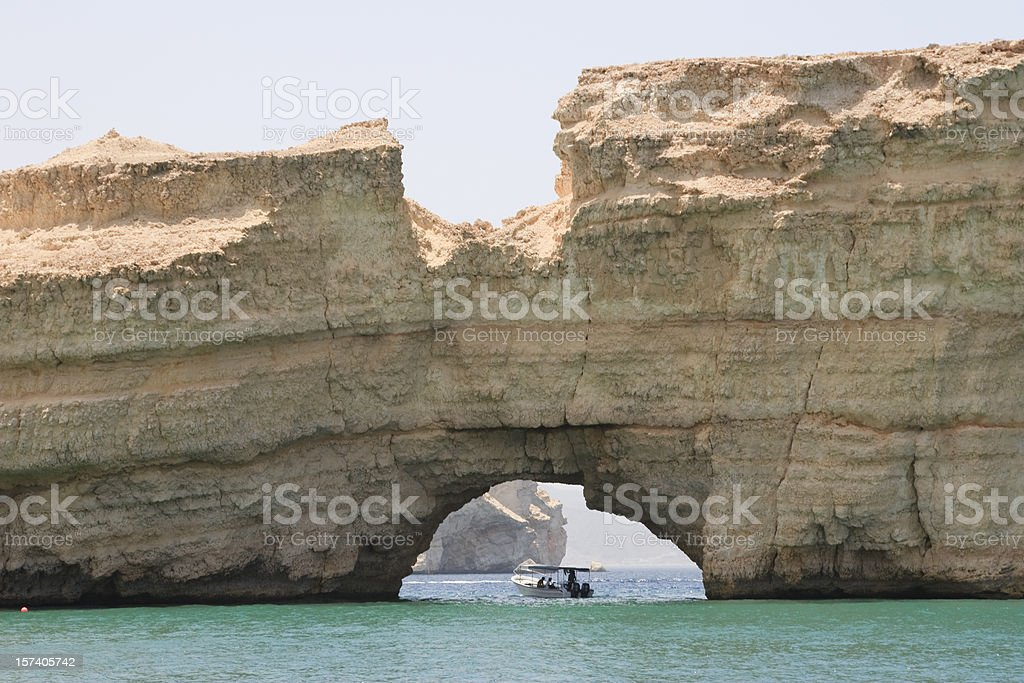 Natural bridge in rocky Oman coastline royalty-free stock photo
