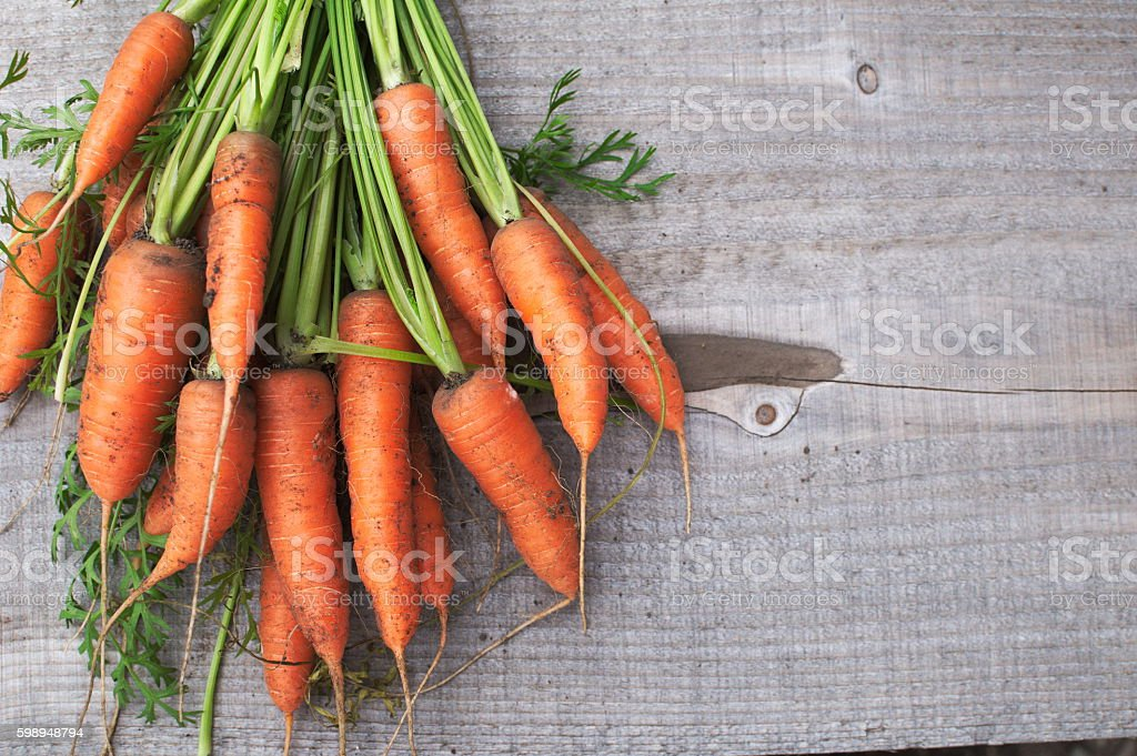 Natural carrots on wood stock photo