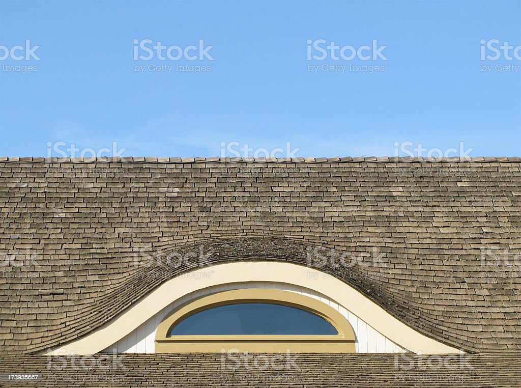 Natural Cedar roof with oriel window and sky. stock photo