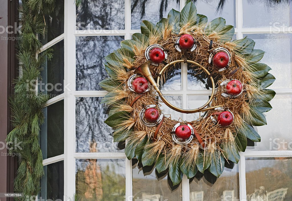 Natural Christmas wreath with apples and pinecones royalty-free stock photo