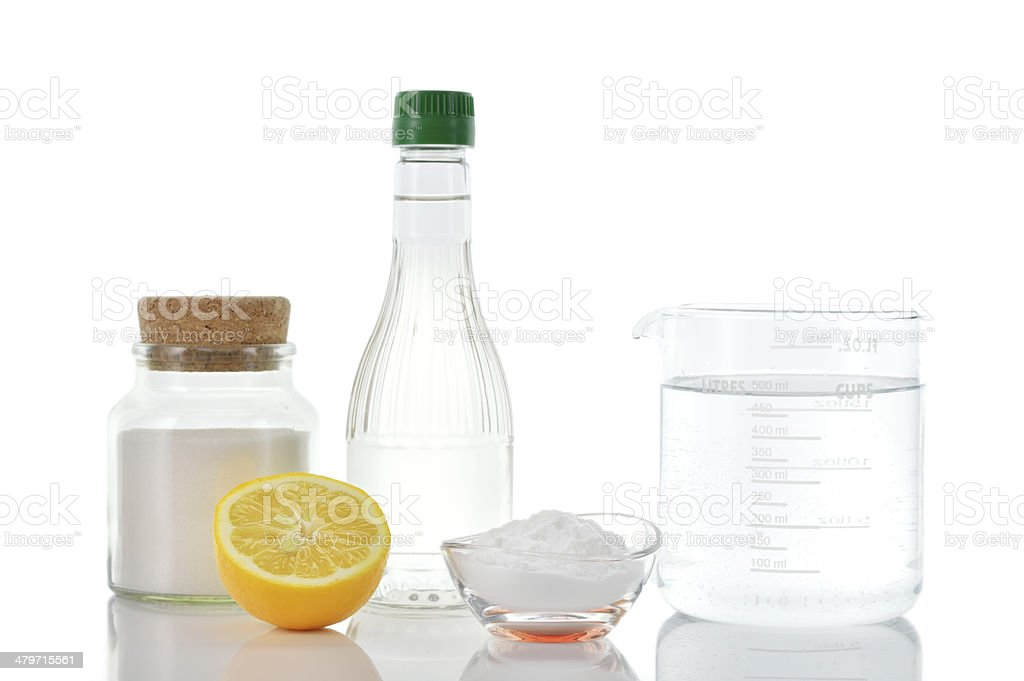 Natural cleaners. Vinegar baking soda salt lemon. stock photo