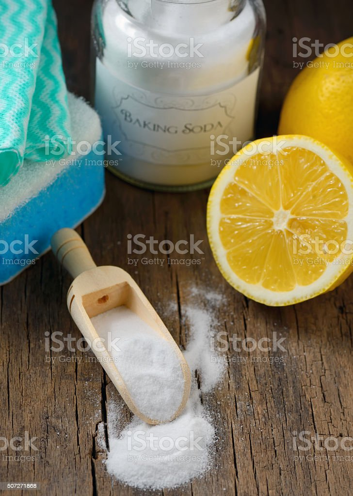 Natural cleaning tools lemon and sodium bicarbonate stock photo