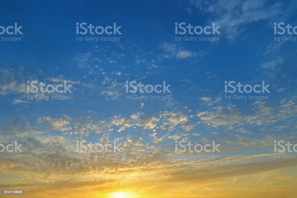 Natural Clouds on blue sky in evening with yellow shade stock photo