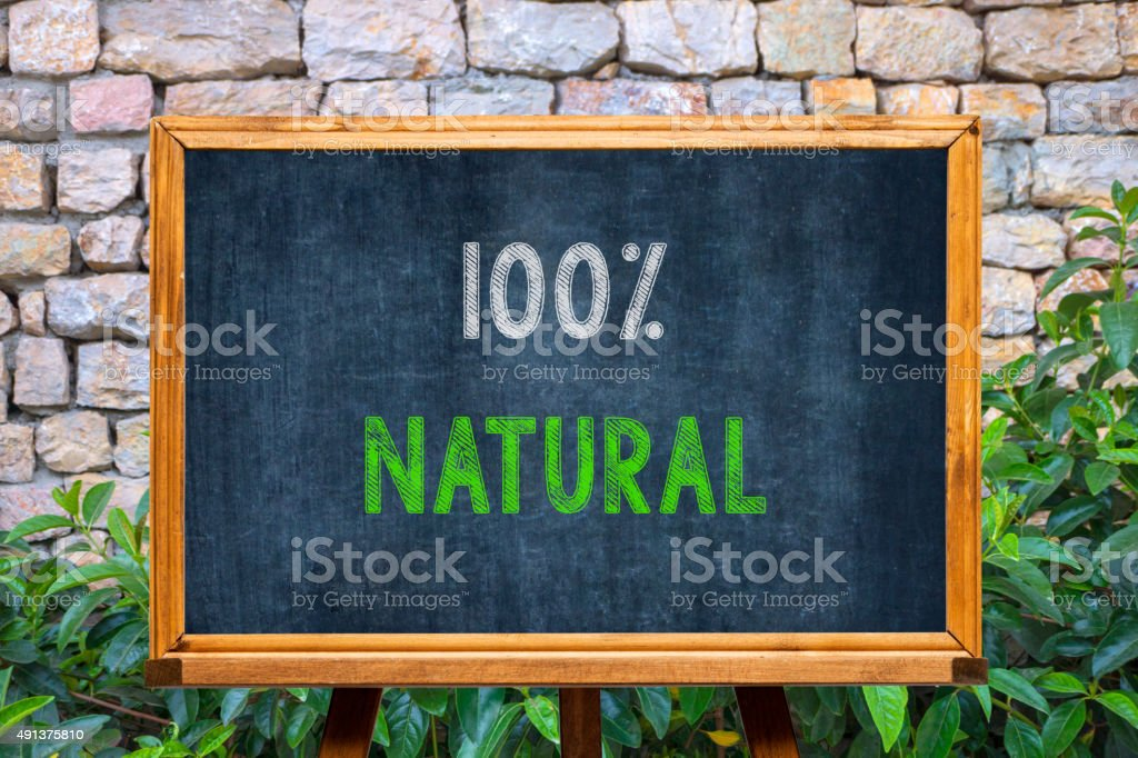100 % Natural Concept on Blackboard stock photo