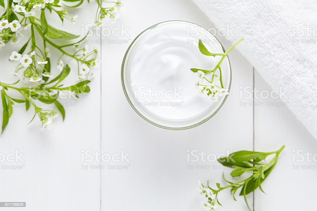 Natural cosmetic cream with herbal flowers skincare product stock photo