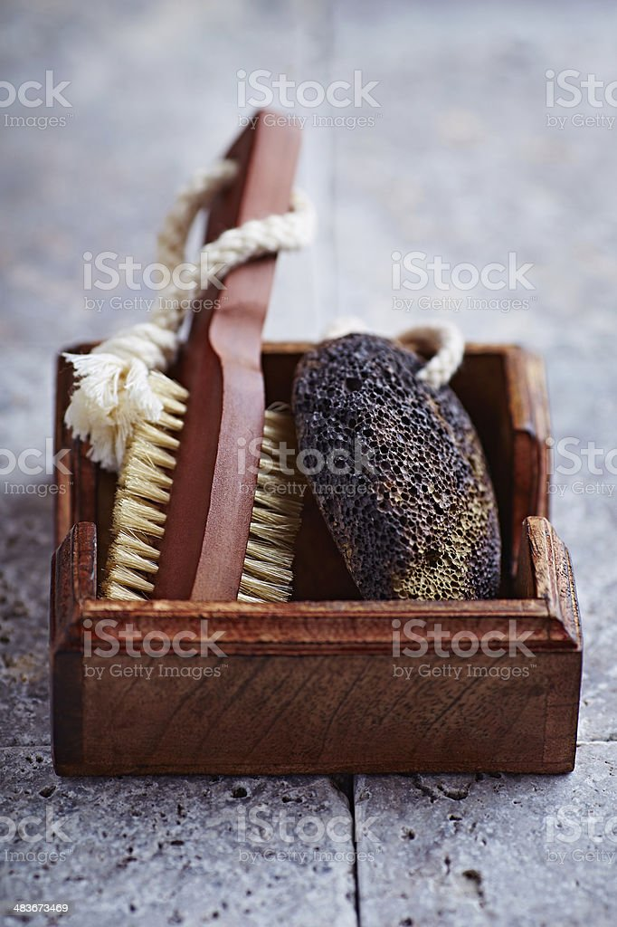 Natural Dark Pumice and a Bath Brush stock photo