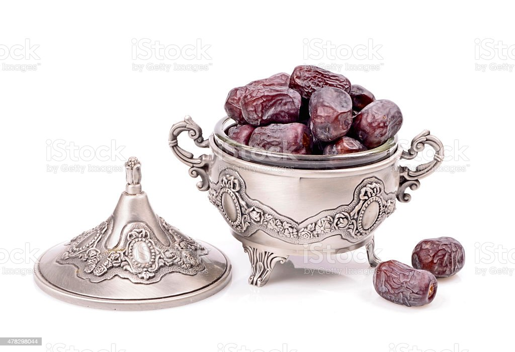Natural dates in a metal container stock photo