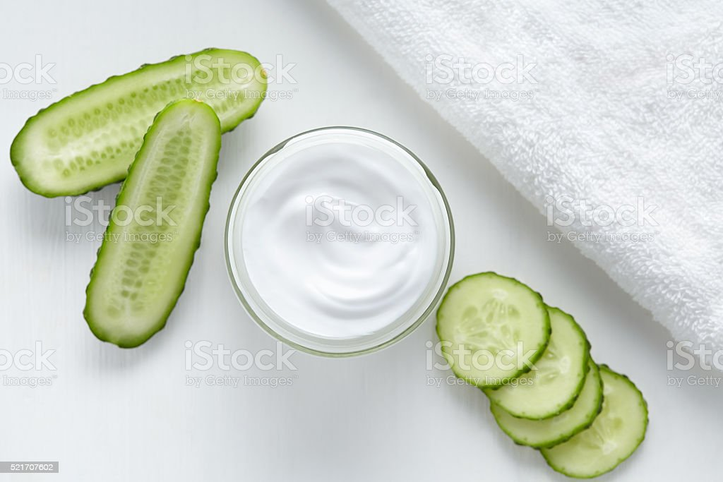 Natural facial cream with cucumber face, skin and body care stock photo