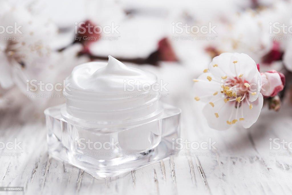 Natural facial cream with spring blossom stock photo