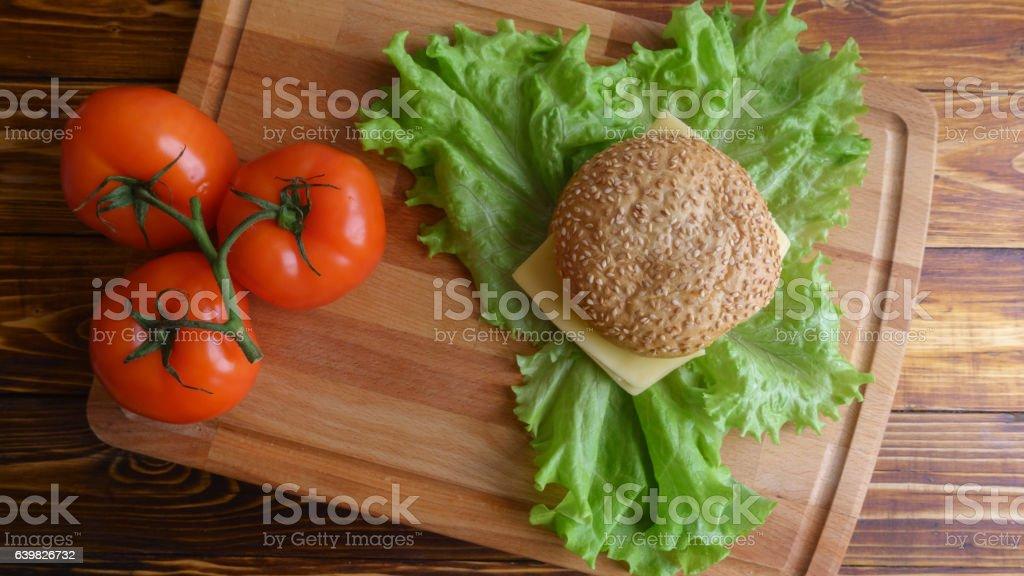 Natural fastfood hamburger top view on salad leaves stock photo