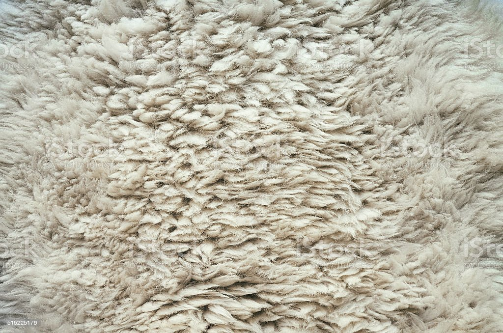 Natural fluffy flat sheep skin stock photo