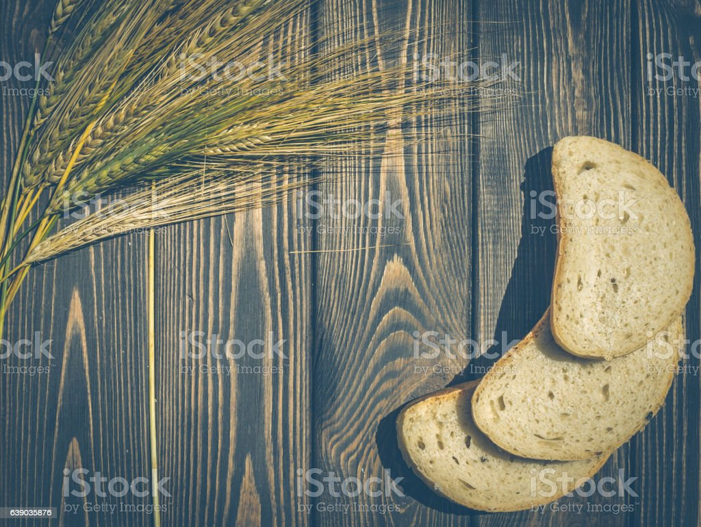 Natural food. Bread and rye ears stock photo