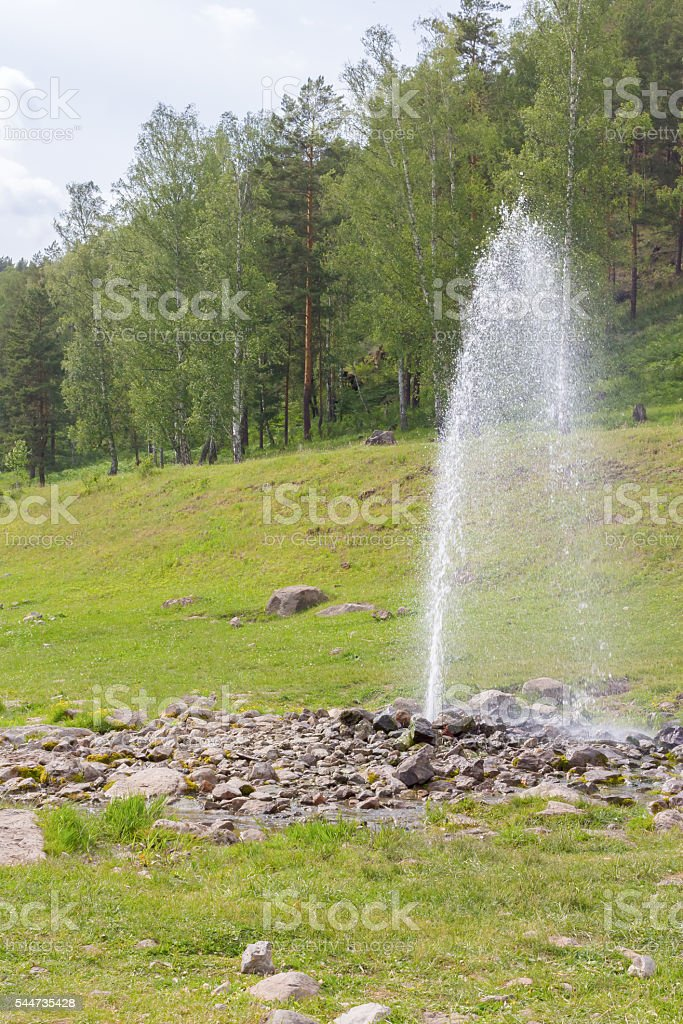Natural fountain spouting from the ground stock photo
