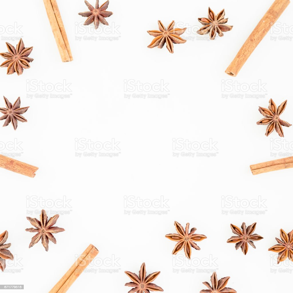 Natural frame of cinnamon and anise tree on white background. Spice. Flat lay. Top view. stock photo