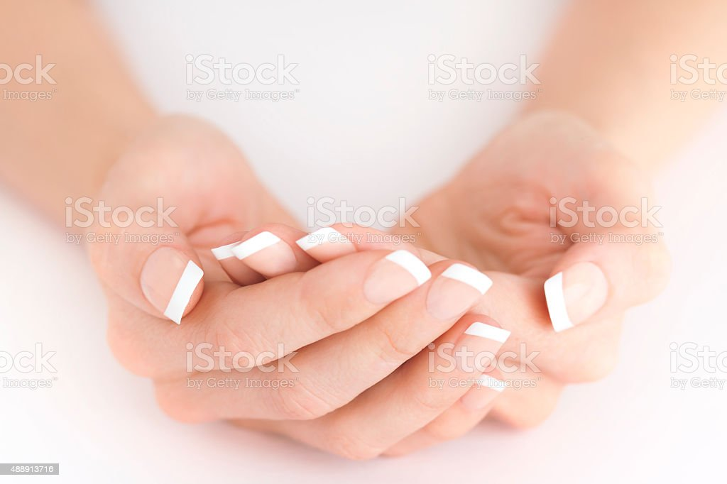 Natural French Manicure Protecting Hands on White Background royalty-free stock photo