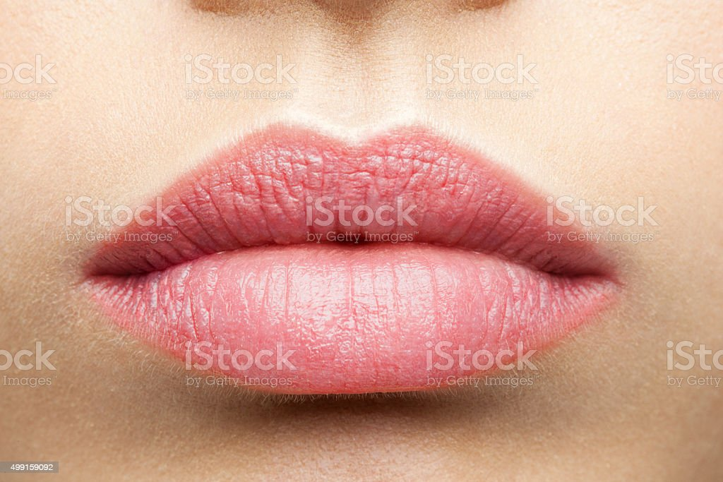 Natural frosted pink lips stock photo