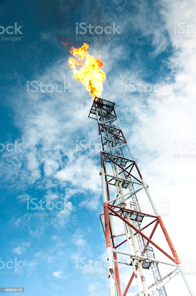 Natural gas buring on a platform stock photo