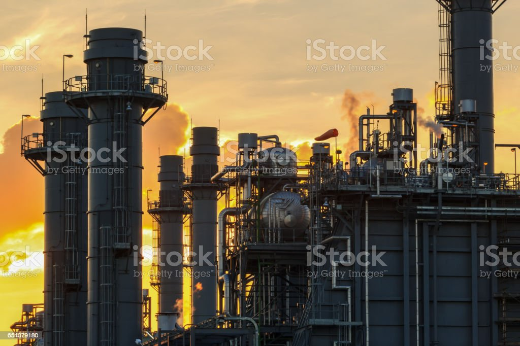 Natural Gas Combined Cycle Electrical Power Plant with golden hour stock photo