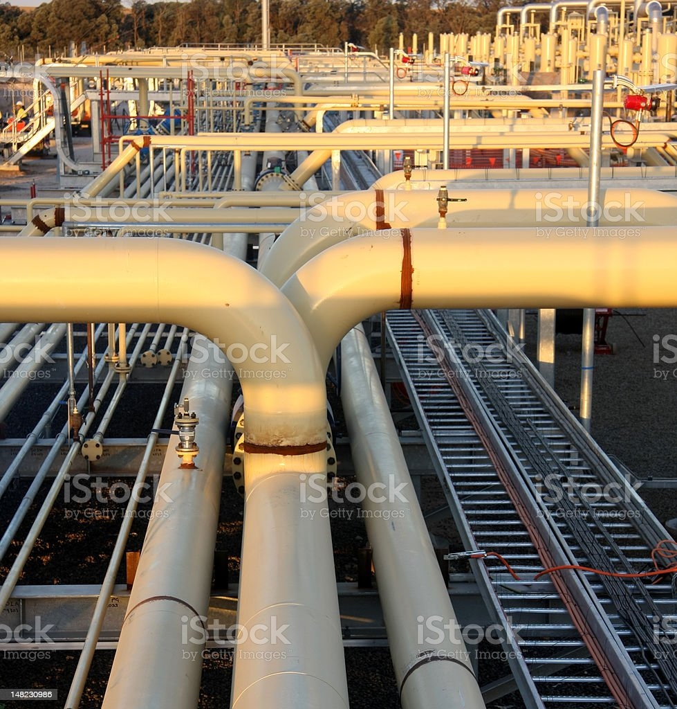 Natural gas compressors and pipelines stock photo