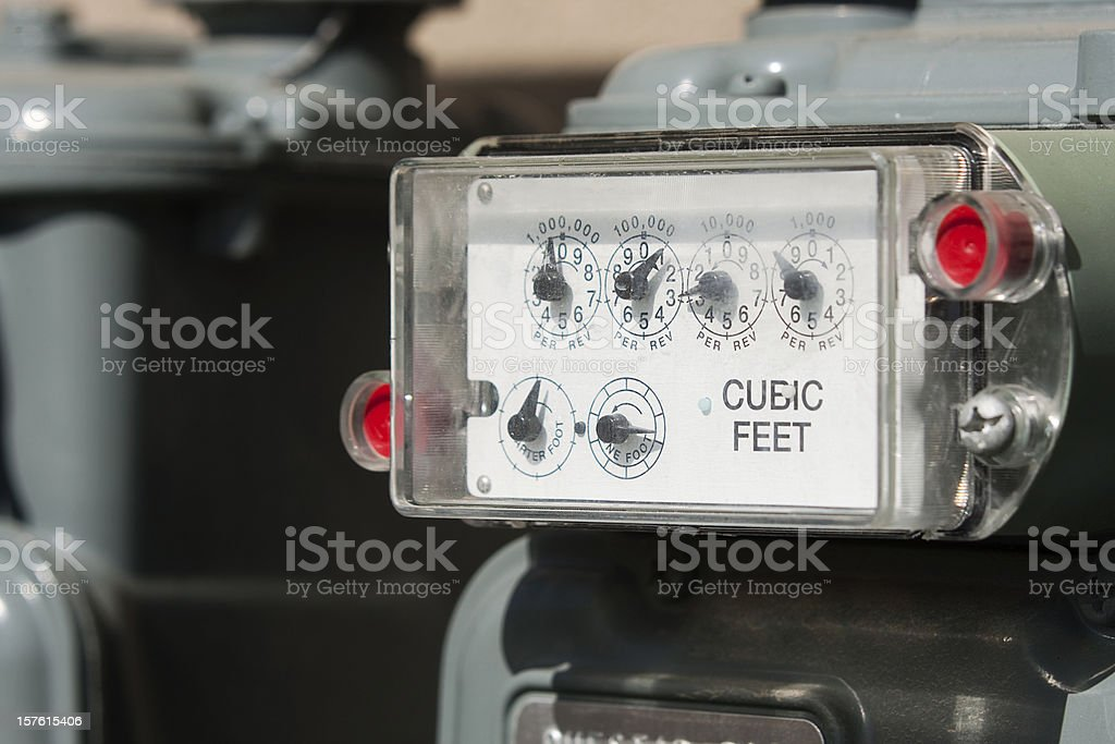 Natural Gas Meter with Multiple Gauges in Plastic Casing royalty-free stock photo