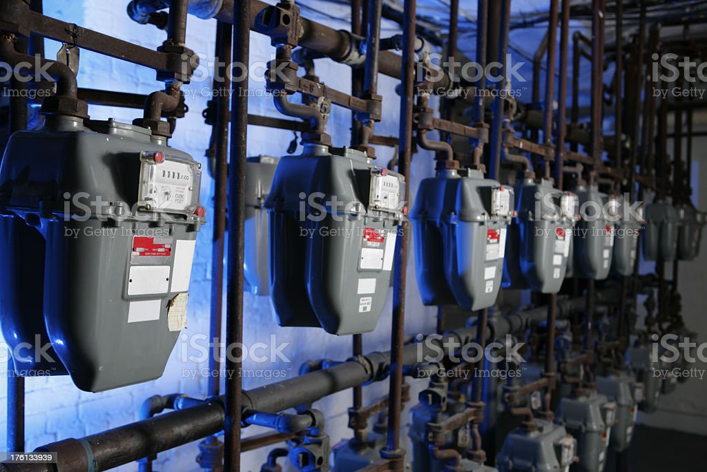 Natural gas meters on the wall royalty-free stock photo