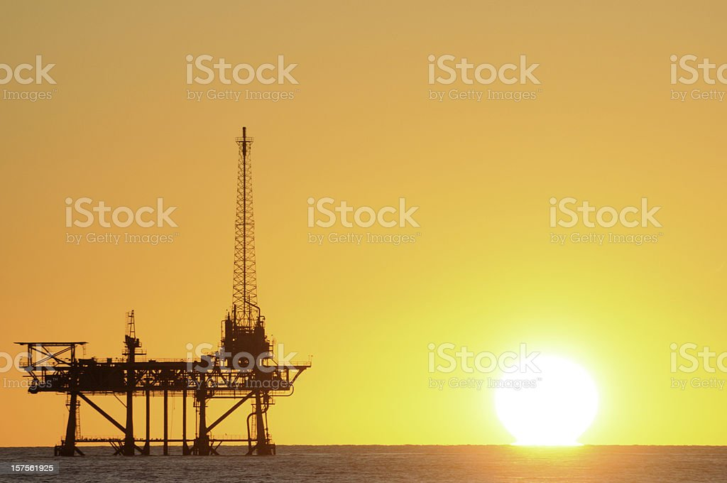 Natural gas platform silouette with sun royalty-free stock photo