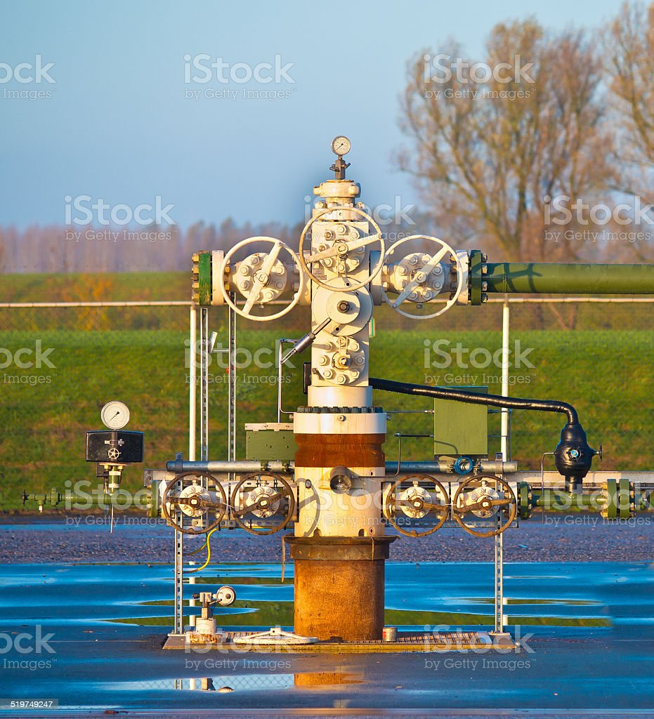 Natural gas production wellhead stock photo